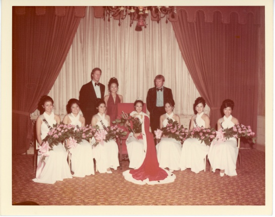 """At the Biltmore Hotel in Los Angeles, Carol Lynn Matsunaga (center) became the 1972 Nisei Week Queen and her Court included, from left to right: Mary Favatella, Carol Fujiwara, Seleste Sakato (1st Princess); Carol Akamatsu, Christine Sumi (Miss Tomodachi), and Carol Watanabe. The three people standing in the back are, from left to right: David Hartman, the first """"Good Morning America"""" anchor, 1971 Nisei Week Queen Joyce Kikuchi, and actor on the right is Kevin Tighe of """"Emergency"""" fame. Carol Matsunaga went on to graduate from Pitzer College in Claremont, CA and UCLA School of Law. She is an attorney in the Los Angeles area."""